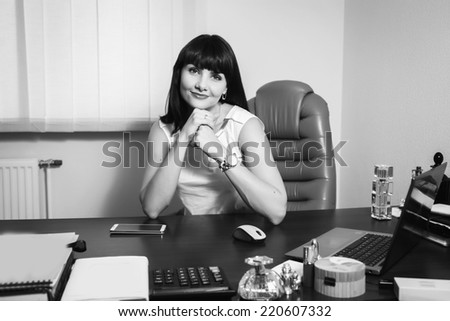 Successful business woman looking confident and smiling.Young pretty business woman with notebook in the office/Candid image of a businesswoman working in a cafe.