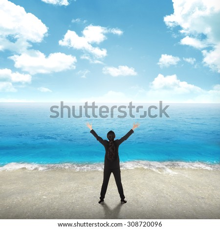 Successful business woman on the beach with blue sky background