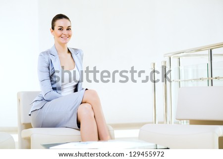 successful business woman sitting in the office, ready for the meeting - stock photo