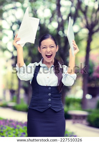 Successful business woman with arms up celebrating. Portrait winning young ecstatic student being winner isolated outside background. Positive human emotion face expression. Life achievement concept - stock photo