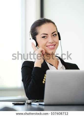 Successful business woman with headset