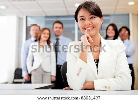 Successful business woman with her team at the office - stock photo