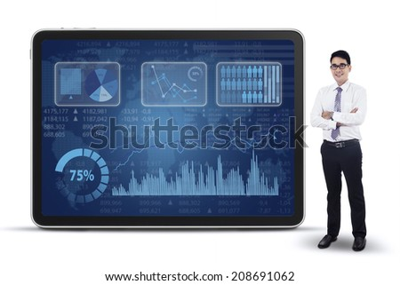 Successful businessman and financial graph on the blackboard