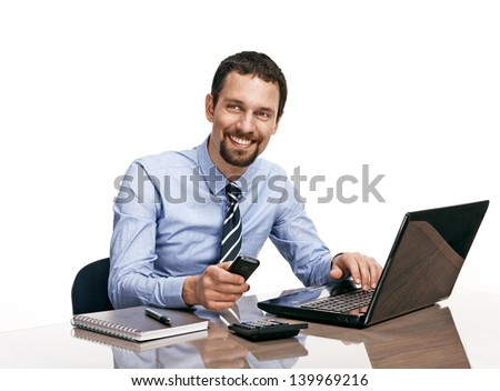 Successful businessman going to make a call by cellphone while working with laptop isolated on white  - stock photo