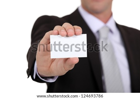 successful businessman holding business card - stock photo