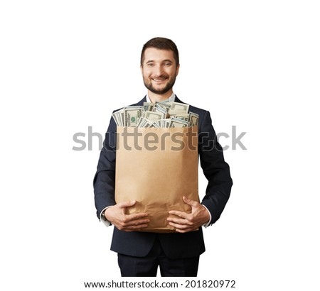 successful businessman holding paper bag with money and smiling. photo in studio over white background - stock photo