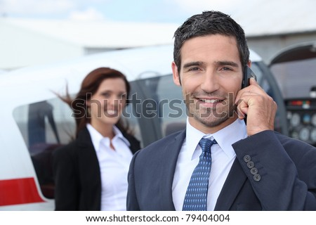 Successful businessman in airport - stock photo