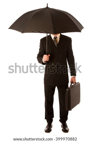Successful businessman in formal suit and briefcase, suitcase standing under black umbrella isolated over white. - stock photo