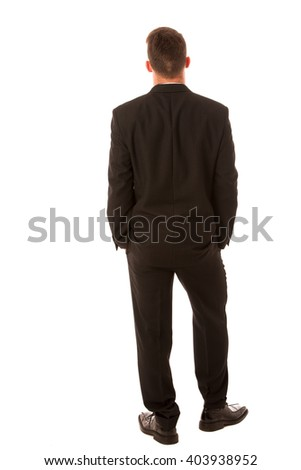 Successful businessman in formal suit confidently standing isolated over white.