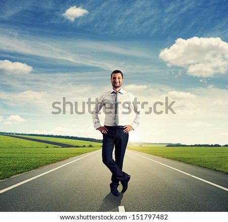 successful businessman in formal wear standing on the road - stock photo