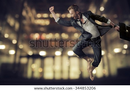 Successful businessman jumping - stock photo
