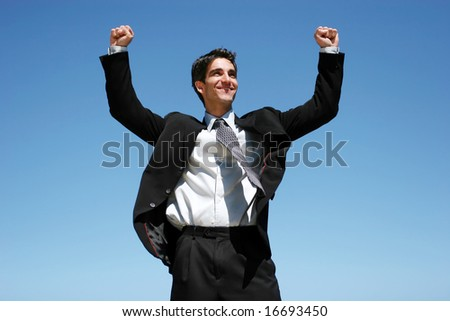 Successful businessman jumping to celebrate - stock photo