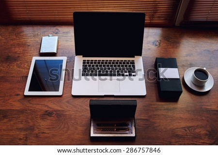 Successful businessman or entrepreneur workspace with style accessories, pen case, open laptop computer and digital tablet with white blank copy space screen, private office table of wealthy person - stock photo