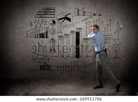 Successful businessman playing golf and business sketches at background - stock photo