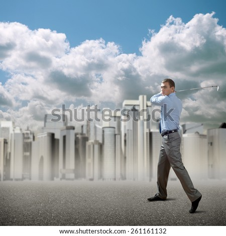 Successful businessman playing golf and skyscraper office buildings