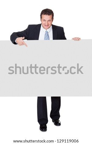 Successful businessman presenting empty banner. Isolated on white background - stock photo
