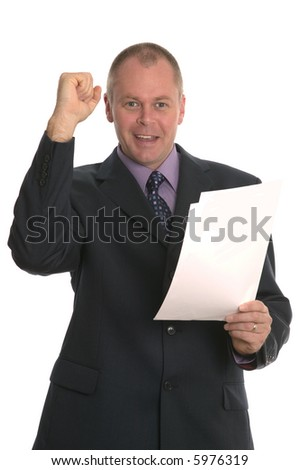 Successful businessman punching the air and holding a document.