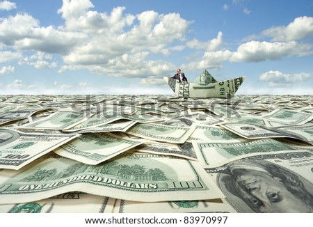 Successful businessman sailing on dollar boat in financial sea - stock photo