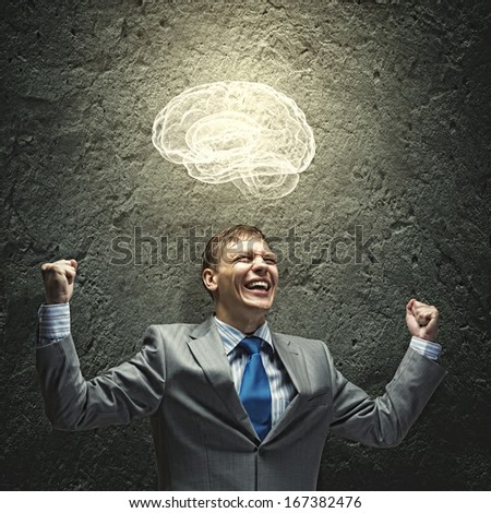 Successful businessman screaming joyfully in to sky - stock photo