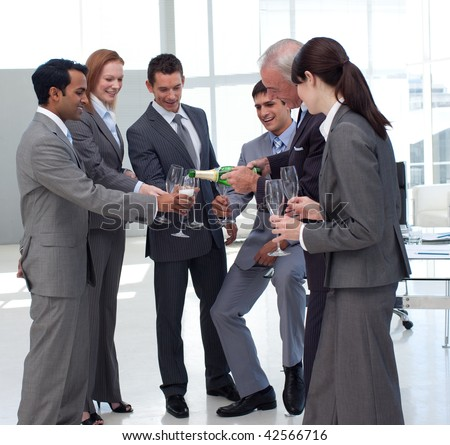 Successful businessman serving Champagne to his colleagues after a success - stock photo