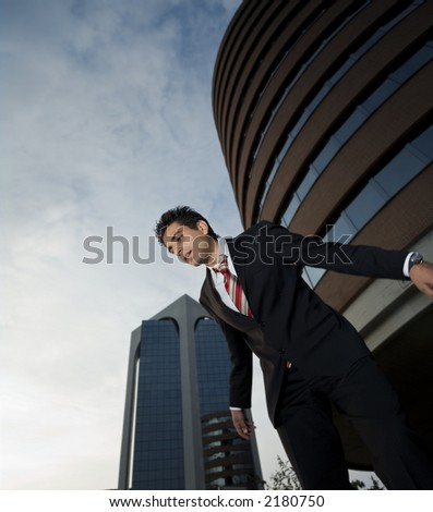 successful businessman staring at the ground a bit worried