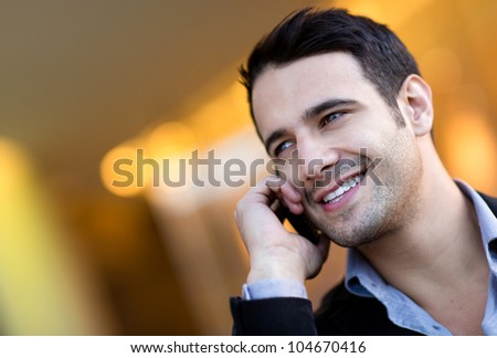 Successful businessman talking on her cell phone - stock photo