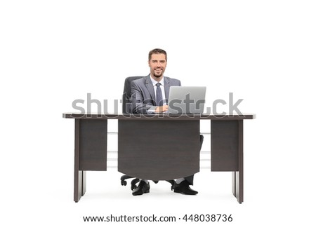 Successful businessman typing on laptop with joy isolated on white