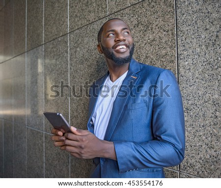 Successful businessman using modern gadget - stock photo
