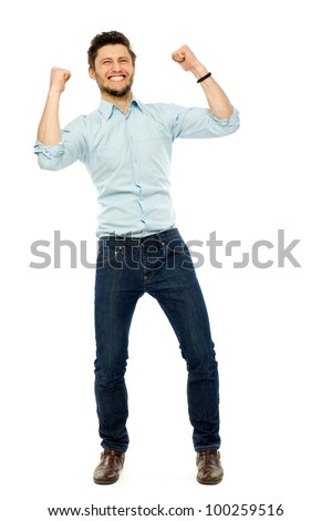 Successful businessman with clenched fists - stock photo