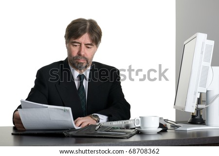 Successful businessman with computer in the office.
