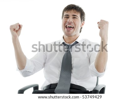 Successful businessman with fists raised