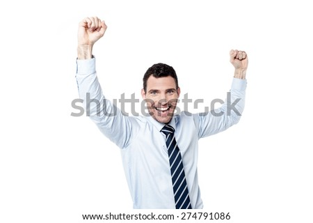 Successful businessman with raising hands - stock photo