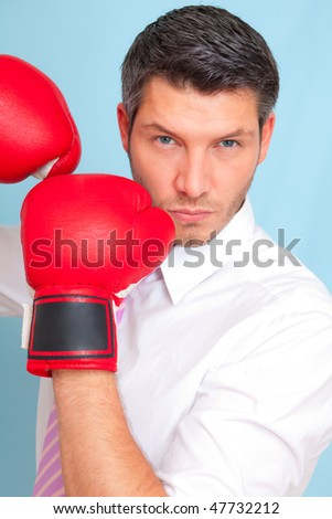Successful businessman with tie portrait wearing boxing hand as concept of business career strength