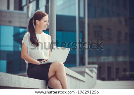 Successful businessman working at laptop. City businesswoman working. - stock photo