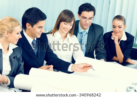 Successful businessteam working together at office - stock photo