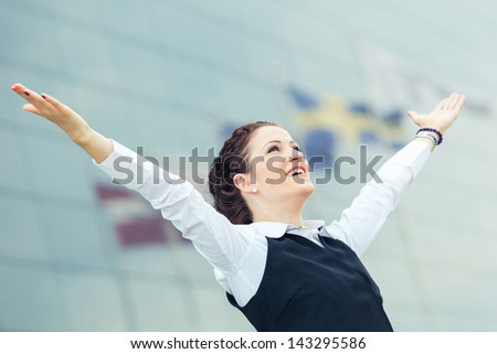 Successful Businesswoman in front Office Buildings - stock photo