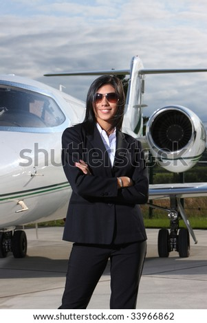 Successful businesswoman with jet - stock photo
