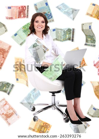 Successful businesswoman with pile of money - stock photo