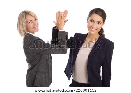 Successful celebrating and isolated businesswoman shaking hands and proud of her success. - stock photo