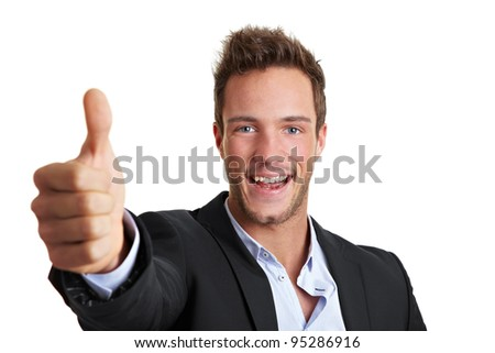 Successful cheering business man holding his thumb up - stock photo
