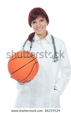 Successful cute young female doctor holding a basketball. Healthy life-style concept - stock photo