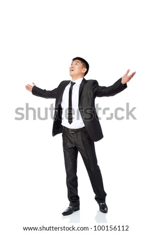 successful excited asian young business man hold fist, full length portrait of businessman with arms wide open hands up wear elegant suit and tie isolated over white background - stock photo