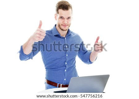 Successful excited business man with laptop happy smile hold thumb up gesture, handsome young businessman with raised hands arms looking to computer, standing at table isolated over white background