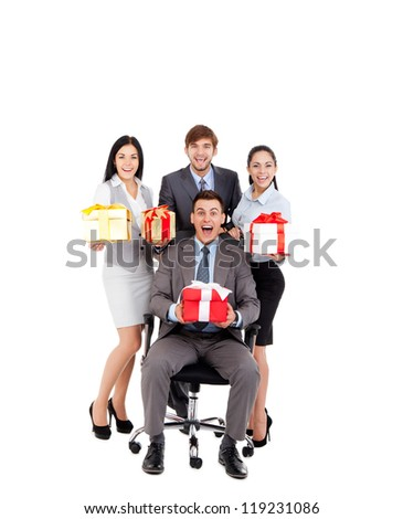 Successful excited Business people group team hold gift box presents, man leader sitting in chair, young businesspeople smile, Isolated over white background - stock photo