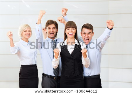 Successful excited Business people group team, young businesspeople smile hold fist ok yes gesture with raised hands arms