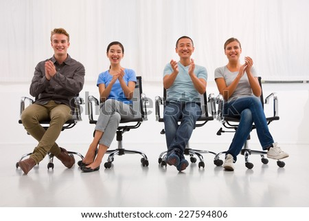 Successful executives applauding office - stock photo