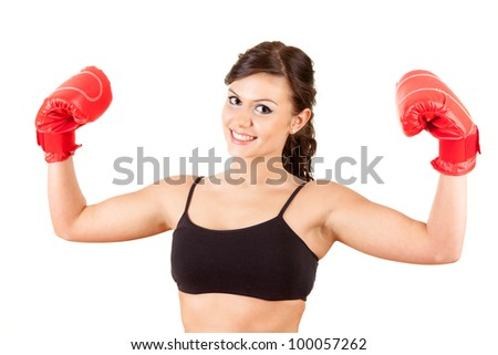 successful girl wearing boxing gloves, white background