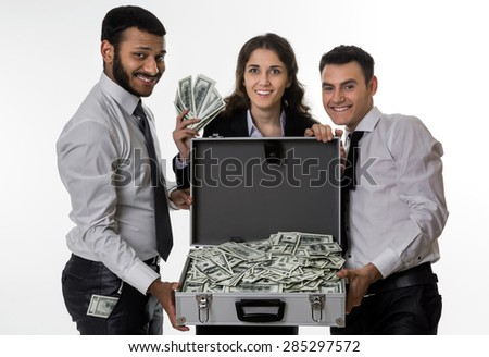 Successful guys share the profits. Partners rejoice money. Happy managers. - stock photo