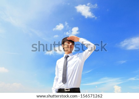 Successful handsome business man purposefully looking away with blue sky, mode is a asian male