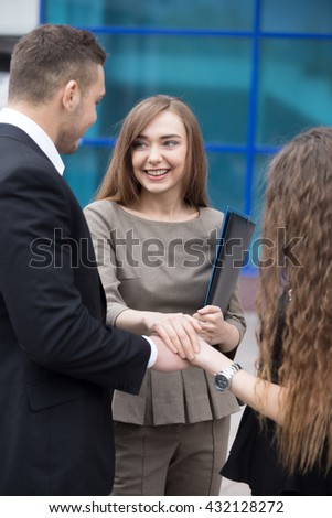 Successful happy business people joining hands working together. Focus on smiling businesswoman. Successful Deal Concept . Businesspeople Teamwork - stock photo